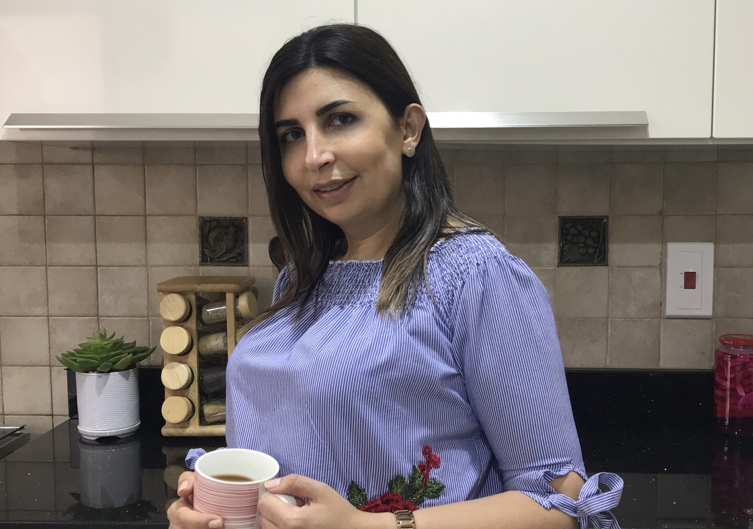 A lady with a cup of coffee