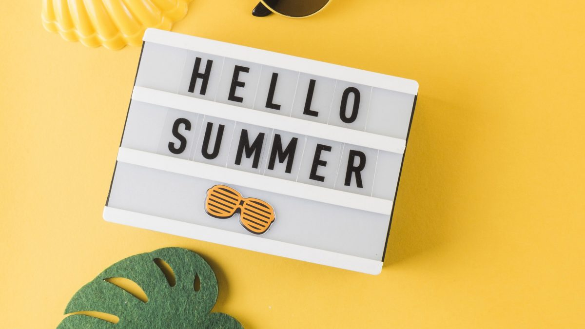 Summer gadgets on a yellow background