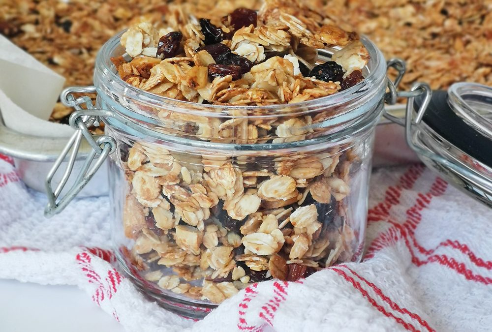 low calorie granola jar with a granola tray behind